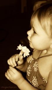 Sasha smelling flower