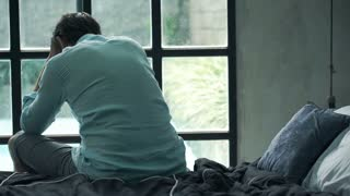 sad-unhappy-man-sitting-on-edge-of-bed-at-home_blxl9tuc_thumbnail-small01